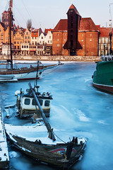 Winter in Gdansk - old boat and the historic crane (hsadura) Tags: 15thcentury citylife europe gdansk martwa moltawa old poland pomerania pomeranian pomorskie pomorze town tricity vistula architecture blue cathedral church city cityscape cold crane day downtown evening house ice illuminated landmark landscape oldtown outdoors panorama river sky skyline snow square street sunny travel winter wooden zuraw