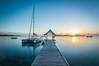Sunrise (sebileiste) Tags: mauritius preskil sunrise indian ocean indischer ozean blau orange langzeit belichtung long exposure steg footbridge katamaran catamaran mahebourg nikon d90 sigma 1020
