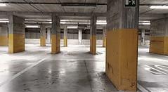 Deserto (Aellevì) Tags: vuoto park parcheggio sotterraneo nessuno giallo colonne pilastri linee uscitadisicurezza