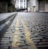 Cobbled lines (Gabo Barreto) Tags: cobblestone cobbles yellowlines road street leeds yorkshire uk dof bokeh focus film kodak portra 400 kiev88 vega12b 120 mediumformar colourfilm colorfilm analoguephotography filmcamera filmisnotdead ishootfilm pov