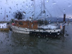 Rainy days (tata-luci) Tags: rain raindrops fishboat wooden boat