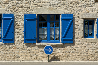 Blue sign and windows