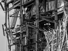 End of an Era (clarkcg photography) Tags: metal beams stairs demolish teardown scrap powerplant gas rivets 1950sconstruction blackandwhite bw blackwhite