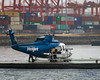 Unloading the Helijet S-76A in the Vancouver Rain (AvgeekJoe) Tags: 760043 britishcolumbia cfzaa canada d5300 dslr helicopter helijet importedkeywordtags nikon nikond5300 s76a sikorskys76a tamron18400mm tamron18400mmf3563diiivchld vancouver aircraft aviation chopper