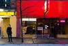 Man talking on cell Phone Granville Street (Margeaux Nicholas) Tags: granvillestreet vancouver bar bench city downtown exterior gritty man neon nightlife oneperson red street urban wet yellow