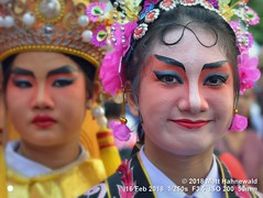 2018-02a Bangkok Chinatown (56) (Matt Hahnewald) Tags: matthahnewaldphotography facingtheworld live aesthetic springfestival chinesenewyear parade performer dancer makeup lunaryear festival head face painted eyes costume consent fun entertainment travel tourism culture tradition enjoyment socialevent diversity impact traditional cultural folklore touristattraction celebration historical yaowarat bangkok chinatown thailand thaichinese asia twopeople image photo faceperception physiognomy nikond3100 primelens 50mm 4x3 horizontal street portrait doubleportrait closeup outdoor color colorful posingforcamera iconic awesome incredible authentic sightseeing partying photography ambiguity attire softfocus chracter relationship seveneighthsview nikkorafs50mmf18g lookingcamera headshot