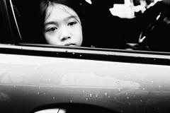 Girl In Passenger Seat (Meljoe San Diego) Tags: meljoesandiego fuji fujifilm x100f streetphotography car reflection candid monochrome philippines