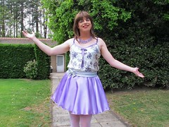 Goodbye (Paula Satijn) Tags: sexy hot girl skirt miniskirt silk satin shiny dress lilac lavender purple garden outside cute sweet adorable sensual happy joy fun girly feminine gurl tgirl tranny necklace violet