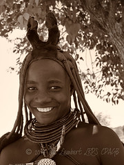 Women who have been married for about a year, or have had a child, wear an ornate headpiece called the Erembe, sculptured into horns and from animal skin (Nanooki ʕ•́ᴥ•̀ʔっ) Tags: africa himba namibia silvereffectspro ©suelambertlrpscpagb kuneneregion na tribe himbatribe potrait