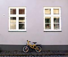 Junior is home, (Jaedde & Sis) Tags: bicycle bike yellow grey house windows number ærøskøbing challengeyouwinner 15challengeswinner pregamewinner flickrchallengewinner flickrchallengegroup