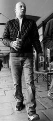 Rights of passage (Neil. Moralee) Tags: neilmoralee neilmoraleenikond7200 man beer bottle drink drinker drunk alcohol booze bald hard low point view lpov lowpointofview bristol street uk black white mono monochrome bold bw bandw blackandwhite couragous walk stride neil moralee nikon d7200 punk candid skin head skinhead powerful