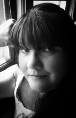 Up to no good (Southern Darlin') Tags: me selfportrait self portrait photo photography bw blackandwhite face mischief woman monochrome mature black white grey feckles pretty trouble grin fine art people