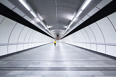 Corridor Symmetry (CoolMcFlash) Tags: tube tunnel corridor subway station architecture person street streetphotography city citylife canon eos 60d sigma 1020mm 35 vienna modern candid symmetry symmetrie symmetrisch geometry geometrie korridor ubahn architektur stadt wien fotografie photography gelb yellow