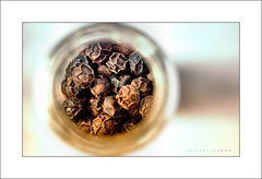 Peppercorn Throng (J Michael Hamon) Tags: macromondays condiment macro spice pepper peppercorn closeup photoborder hamon nikon d3200 nikkor 40mm stilllife kitchen texture jar bottle