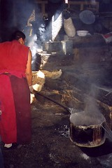 Monastery Masterchef (slide 2003) (vittorio vida) Tags: tibet monastery cook masterchef cooking kitchen monk red asia china