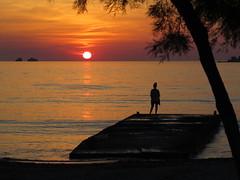 paros, greece (gerben more) Tags: paros greece sun sunset water sea woman tree