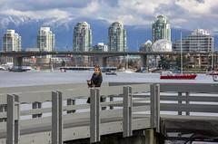 Who's Walking Who? (Clayton Perry Photoworks) Tags: vancouver bc canada spring explorebc explorecanada skyline seawall people falsecreek