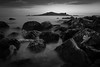 Time goes by (so slowly) (parenthesedemparenthese@yahoo.com) Tags: dem bw beach blackwandwhite longexposure monochrome nb noiretblanc rocks sky canoneos600d ciel dublin ef24mmf28 howth ile ireland island mer pauselongue plage printemps rochers sea spring