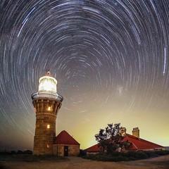 Light house (WombatCat) Tags: nightlights lighthouse nightsky night stars longexposure sony startrails