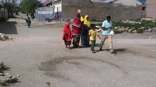 A family walking down the street in Borama