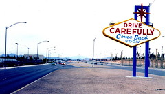Leaving Las Vegas (J_Piks) Tags: usa road highway sign roadsign lamppost streetlights streetlamps leaving lasvegas nevada