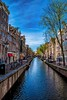 Looking Down the Canal (Charles Patrick Ewing) Tags: landscape landcsapes cityscapes street amsterdam canal blue sky skies water treet trees buildings new all fave faves horizon everything beauty beautiful outdoor europe european holland netherlands art artitstic best top first