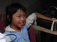 Tam Ky-1F-April 2010 077 (PDC Global) Tags: pdc sewing sew machine clothing sempstress job clothes culture kid youth young child children kids joy happiness smiling smile smiles happy joyful fun tamkỳ tamky vietnam 2010
