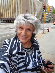 """Downtown Milwaukee, At The Corner Of """"Walk"""" And """"Don't Walk"""" (Laurette Victoria) Tags: downtown raincoat milwaukee silver woman laurette"""
