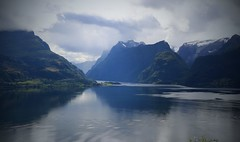Floatation (annazelei) Tags: sky mountain landscape paysage water wasser lake mountainside bay serene norway fjord natura natural naturaleza weather blur vacation summer light dusk beach clouds scenery land snow