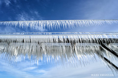 Spectacular Icicles (mswan777) Tags: 1855mm nikkor d5100 nikon stjoseph water wave icicle sharp lakemichigan pattern detail scenic pier metal blue sky winter cold outdoor frozen ice