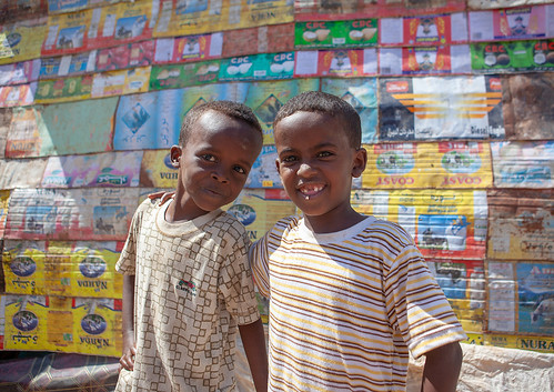 Two somalis boys in front of a house made of recycled stuff, North-Western province, Berbera, Somaliland