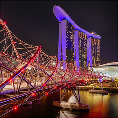 Helix Bridge, Singapore (Richard__Fulcher) Tags: lights beautiful nighttime design bridge river shapes people helix singapore cityscape nightscape longexposure architecture marina