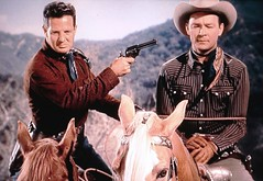 "An outlaw escapes from jail with Roy Rogers as a hostage in ""Sunset in the West"" (1950) (lhboudreau) Tags: movie film motionpicture western wildwest cowboy cowboys cowboyhero westernhero cowboyfilm classicwestern cowboymovie royrogers republicpicture republicpictures republic 1950 sunsetinthewest color americanwest williamwitney jackamarta hat scarf gun sixgun horse trigger palomino cowboystar moviestar harness people screenshot horses animal animals rope ropetied bound hostage outlaw gloves scarves outdoor outdoors gunbelts"