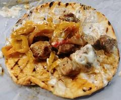 Pork souvlaki in a pita (Will S.) Tags: mypics burlington ontario canada charcoalpit restaurant food souvlaki pork pita onions tzazikisauce bananapeppers