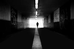 light at the end of the tunnel (Daz Smith) Tags: dazsmith fujixt20 fuji xt20 andwhite bath city streetphotography people candid portrait citylife thecity urban streets uk monochrome blancoynegro blackandwhite mono woman walking tunnel underground dark line lights