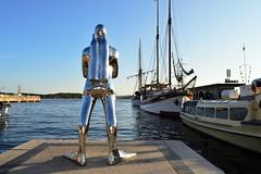 Metallic Diver (Royfir.photography) Tags: man metallic diver chrome sea boats blue sky