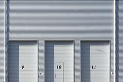 Nine, ten and eleven (Jan van der Wolf) Tags: map17232ve 9 10 11 doors deuren gevel regenpijp drains pipes rainpipe numbers nummers grey grijs monochrome minimalism monochroom architecture architectuur shadow shadowplay shadows schaduw schaduwen schaduwspel facade nine ten eleven