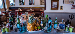 2018 - Mexico City - Restaurante Primos Condesa - 3 of 4 (Ted's photos - Returns 23 Jun) Tags: 2018 cdmx cityofmexico cropped mexico mexicocity nikon nikond750 nikonfx tedmcgrath tedsphotos tedsphotosmexico vignetting boodlesgin pineapple fruit drinks booze gin bottles cans cafe restaurant primos primoscondesa pellegrino bottledwater beefeater beefeatergin bombay bombaygin tables tablesetting chairs berries strawberries