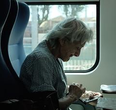 new technology.. (#mimesi) Tags: donna anziana treno tecnologia mistero viaggio colore fujix venezia stazione