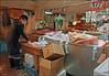 Tsukiji Fish Market - Tokyo, Japan (TravelsWithDan) Tags: man building fish urban city tokyofishmarket boots mask garbage mess untidy boxes candid tokyo japan tsukijifishmarket indoors canong3x ngc
