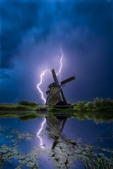 Stormy Kinderdijk (l.cutolo) Tags: glow park hdr dutchscape lightings sharpfocusinthecentre landscape softlights scape stormyweather intensecolours oldtime holland lucacutolo onone greenfield storm travel softfocus hdrscape beautifulholland bluehours lovelyvillages foliage clouddetails dreamers flickr cloudytomapped windmill purpleflowers perfecteffect kinderdijk worldtrekker 07stops world e16mmf28