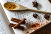 cinnamon and anise (kyrsos.) Tags: book cook wooden spoon cinamon staranise pepper hot cookbook old vintage eat diet culinary spices food greatphotographers