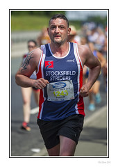Stocksfield Strider (Seven_Wishes) Tags: newcastleupontyne canoneos1dmarkiv canonef70200mmf28lisii outdoor photoborder blaydonrace sportingevent runners running dof depthoffield athlete sport sporting roadrace edoliverphotography 2018 people person shorts vest runningvest sweating sweaty tyneandwear uk views5k