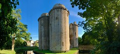 Nunney Castle near Frome in Somerset using the panoramic setting on my phone (baldychops) Tags: moated medieval tranquility tranquil peaceful quiet beautiful panoramic panorama village phone iphone trees tree moat water bridge summer outdoor ruin architecture building historic history old nunneycastle somerset castle nunney