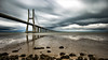 Infinite (Artur Tomaz Photography) Tags: bridge lisbon le longexposition clouds drama blue yellow sea river sand water land rocky rocks landscape