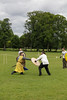 Historia Normannis Meadows June 2018-773 (Philip Gillespie) Tags: historia normannis central scotland sparring fighting shields swords axes spears park grass canon 5dsr men man women woman kids boys girls arms feet hands faces heads legs shins running outdoor tabards chain mail chainmail helmets hats glasses sun clouds sky teams solo dead act acting colour color blue green red yellow orange white black hair practice open tutorial defending attacking volunteer amateur kneeling fallen down jumping pretty athletic activity hit punch