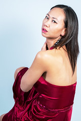 Looking Back in Burgundy Dress (Lexmax08) Tags: asian vietnamese studio beautiful woman female model sitting burgundy white dress bare back shoulder serious