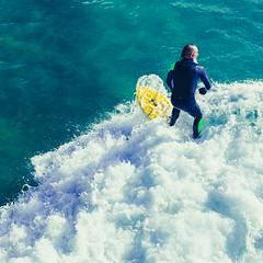 Sea rider (theoswald) Tags: blue basquecountry concha rider yellow cantabric foam surf seascape donosti sansebastián waves sea