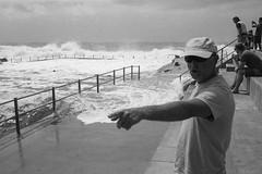 storm waves, Dee Why pool, Sydney 2017  #919 (lynnb's snaps) Tags: apx100 leicaiiic rodinal beach film rangefinder 2017 cv35mmf25colorskoparltm agfaapx100 barnack deewhy rockpool swimmingpool danger stormy stormswells bigwaves sydney australia dramatic nature ocean coast man pointing blackandwhite bw bianconegro bianconero blackwhite biancoenero blancoynegro noiretblanc monochrome schwarzweis watching