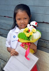 a recent graduate (the foreign photographer - ฝรั่งถ่) Tags: child girl bouquet school uniform paper khlong thanon portraits bangkhen bangkok thailand nikon d3200
